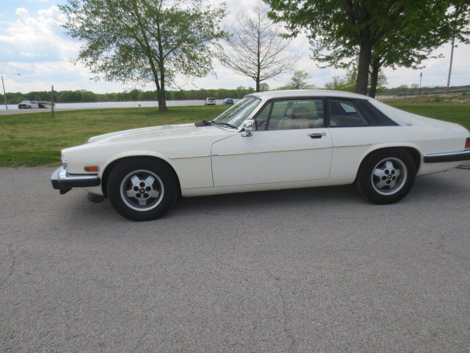 Car brand auctioned jaguar xjs base coupe 2 door 1983 car model jaguar xjs