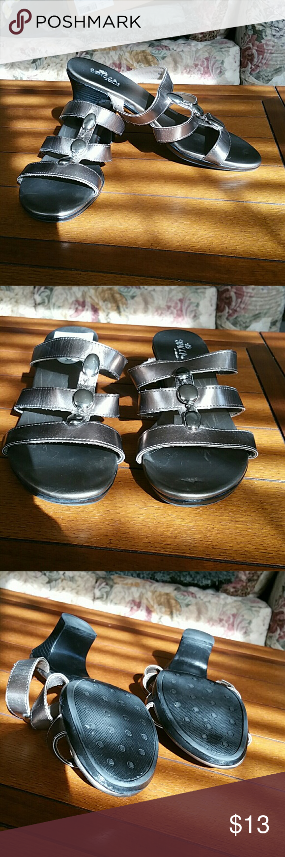 NWT SBICCA GOLD SLIP ON SANDALS SZ 9B Goldtone SBICCA slides. Never worn. Made of man made materials. Flashy accents on top of shoes. Sbicca Shoes Sandals
