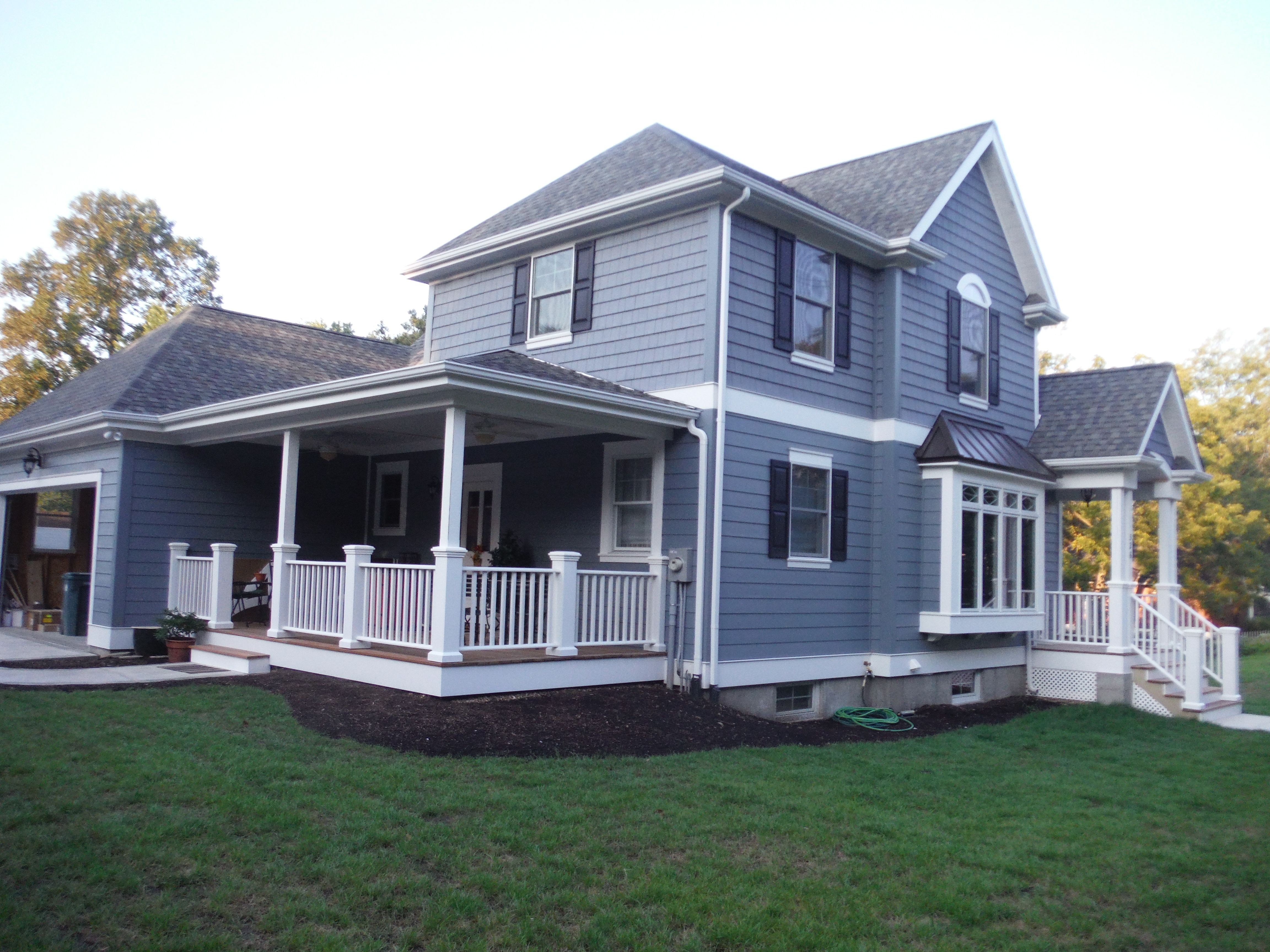 Here Is The Front Of The House Featuring Hardie Boothbay Blue Lap Siding Certainteed Vinyl Perfection Shingle Siding Blue Siding House Exterior Color Schemes