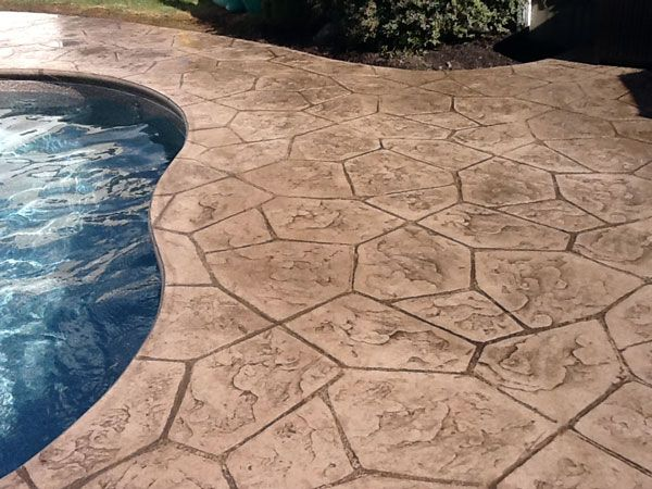 Darker Concrete Stain Colors On Pool Decks Can Really Make The