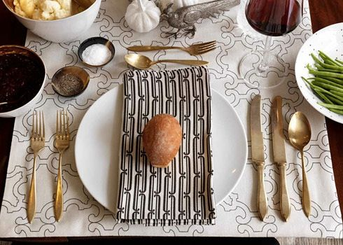 Beautiful place-setting. Can't get enough of gold flatware.
