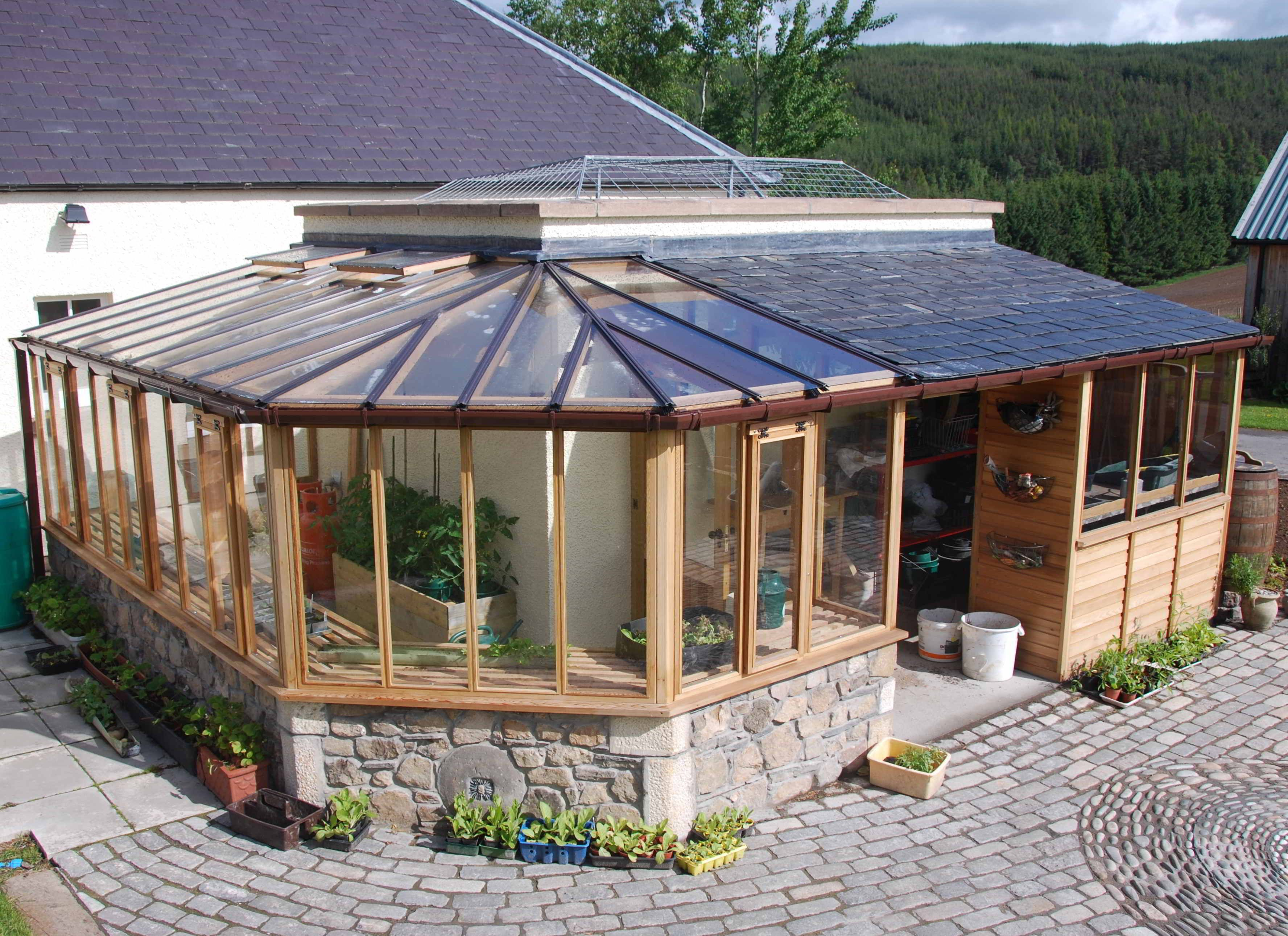 Backyard Greenhouse Ideas the purpose of greenhouses is to allow gardeners to grow a wider variety of plants and flowers no matter the growing zone and to extend the growing season Inspiring Decorating Modern Greenhouse Design