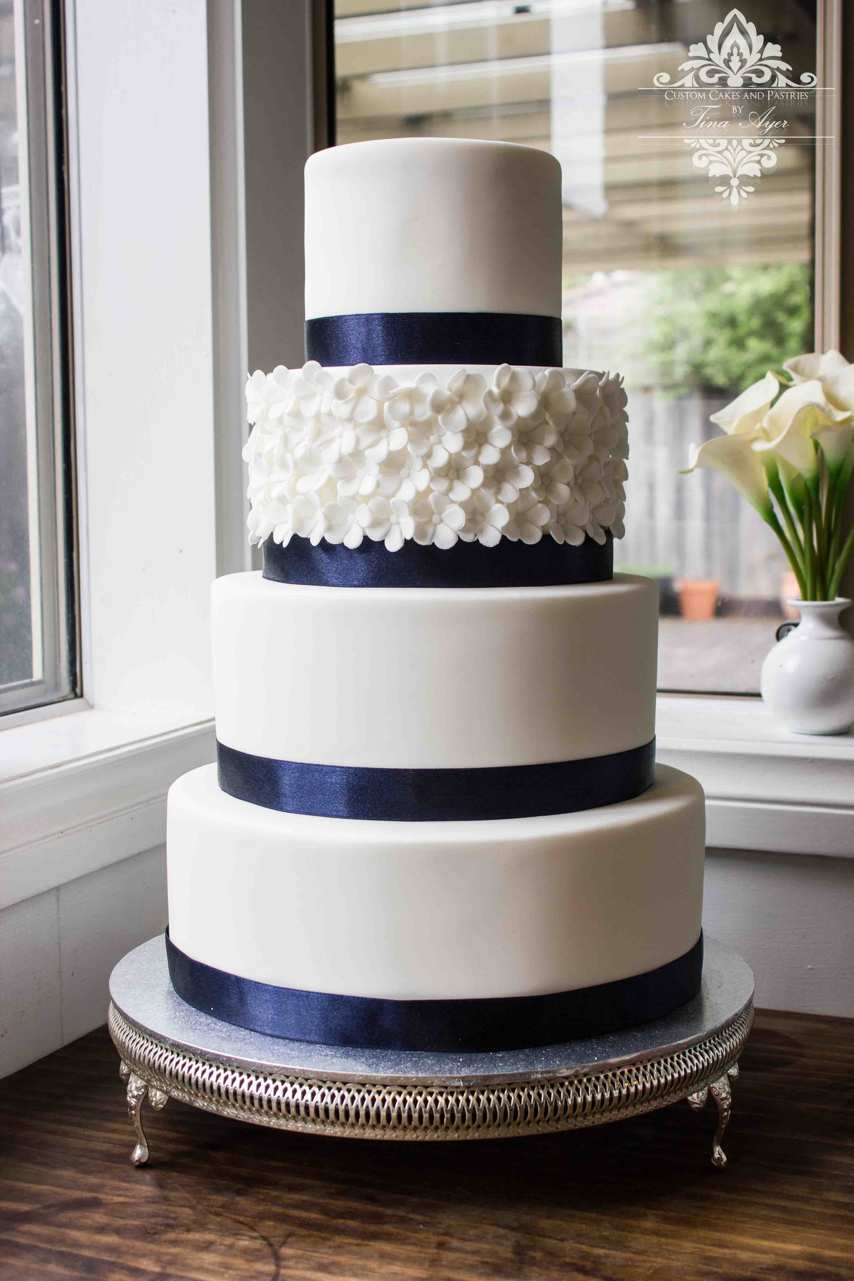 White and Navy wedding Cake with hydrangea flower tier on a vintage ...