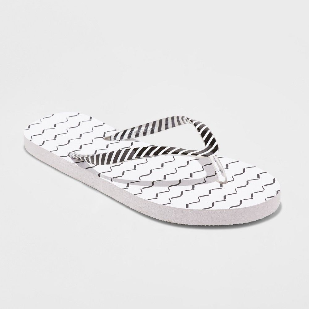 15e8217b892 Whether you re headed to the beach or a barbecue finish off your summertime  style with the Letty Flip-Flop Sandals from Xhilaration. These simple flip- flops ...