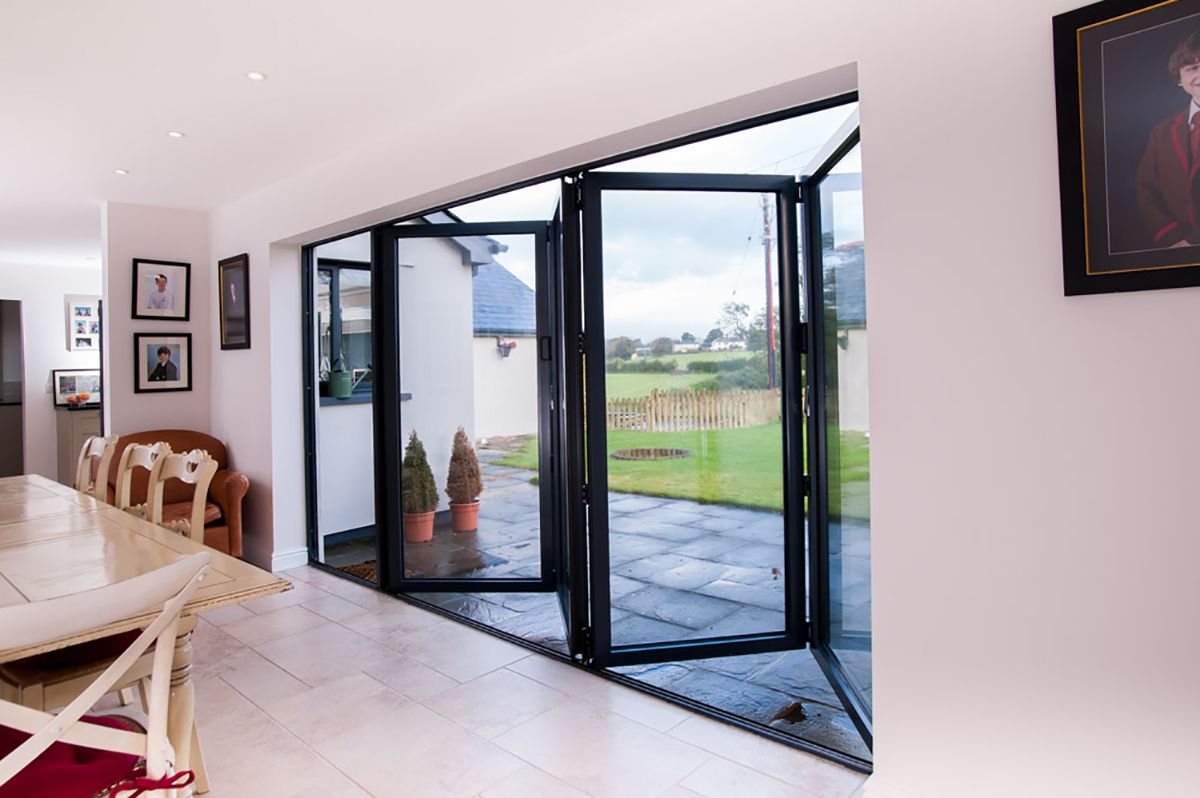 Aluminium Bifolding Doors From Gfd Homes To Suit Any Home From The Simplest To Most Complex We Can Help Availabl Bifold Doors Dining Room Cozy Storey Homes