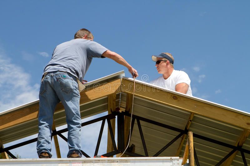 Roofing Construction Workers Apply Sheet Metal To A Barn Roof Sponsored Workers Apply Roofing Construction Bar Roofing Construction Worker Roofer