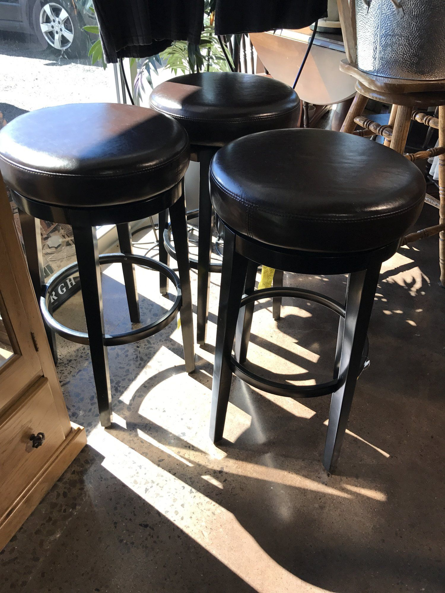 These three Pier 1 swivel bar stools are in great shape. The top is ...