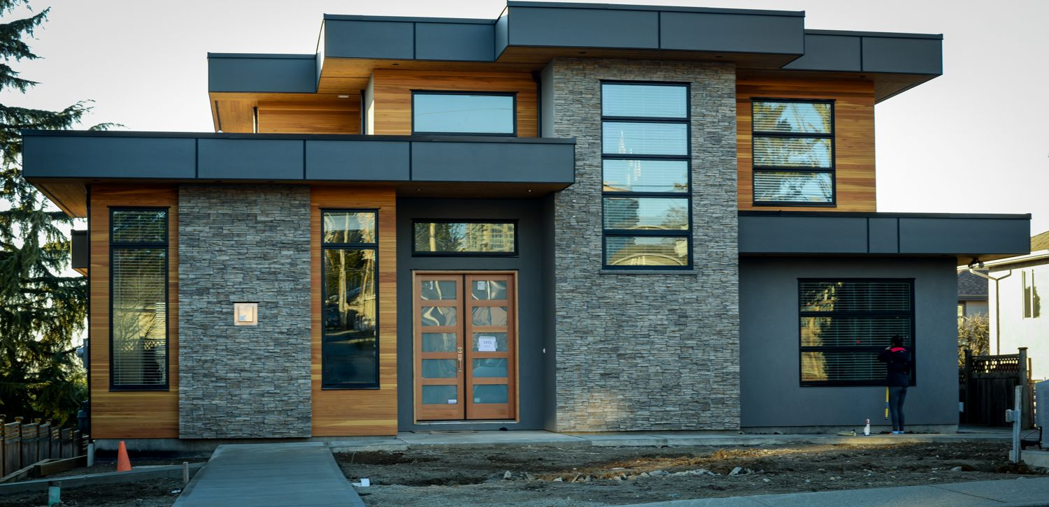 Modern home with grey stone and cedar and black trim Contemporary house builders