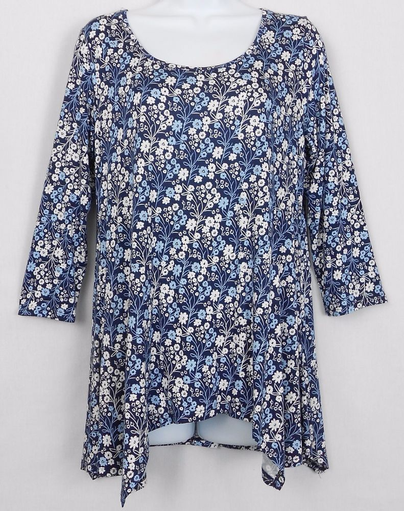 a5bd074e138 Pair this women s Cupio size medium 3 4 sleeve floral print hi-low  sharkbite hem stretch top with your favorite leggings