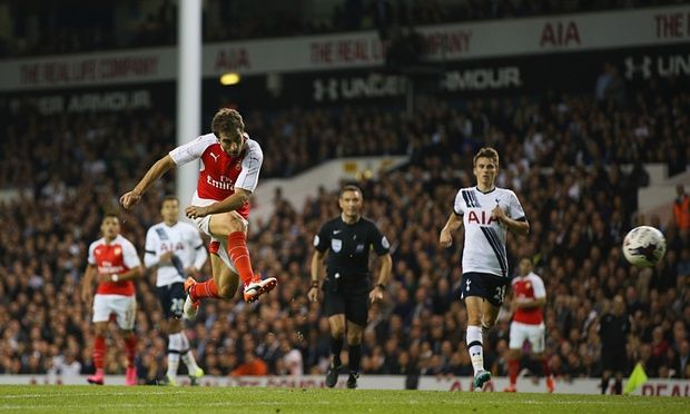 Mathieu Flamini scores the winning goal for Arsenal, in a 2-1 Capital One cup win against Tottenham, with a superb volley