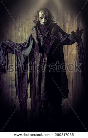 Scary man in iron mask and black robe. Fantasy. Halloween. - stock photo 7ae5c168c649