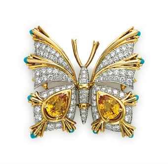 YELLOW SAPPHIRE, TURQUOISE AND DIAMOND BUTTERFLY BROOCH, BY JEAN SCHLUMBERGER, TIFFANY & CO. Designed as a circular-cut diamond and sculpted gold butterfly, with pear-shaped yellow sapphire and cabochon turquoise wings, 1 1/2 ins., for platinum and 18k gold Signed Schlumberger Std.