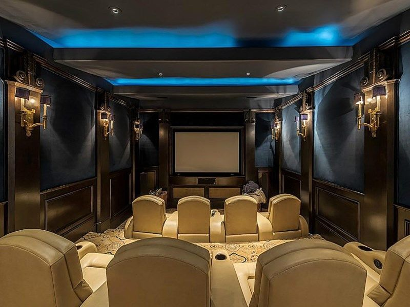 Traditional Home Theater with Wainscoting, Wall sconce, Carpet ...