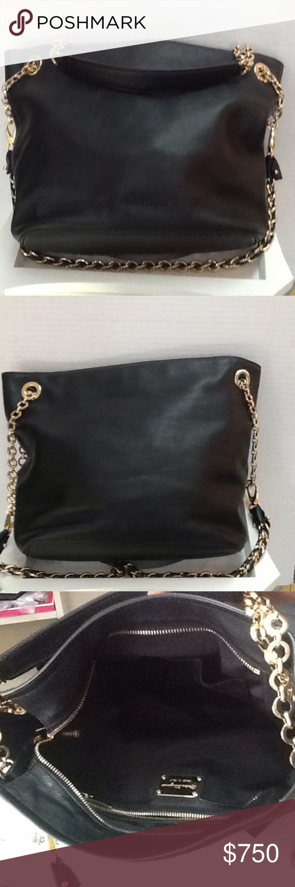 "Authentic Salvatore Ferragamo Malia Handbag Pre-owned in excellent condition. Authentic Ferragamo Malia Handbag with Gold Hadware..14.5"" lenght x 11"" height. Ferragamo Bags Hobos"