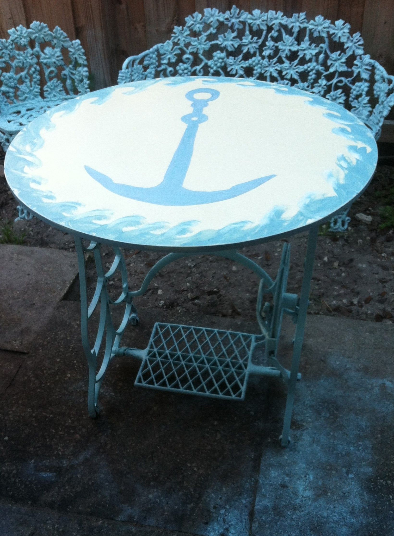 I made this table from an antique sewing base.  I hand painted the anchor and waves on the table and gave it a couple coats of polyurethane.  $149.  Available at:  An Owl's Bazaar, Satellite Beach, Fl. 32937 Thanks for lookin' :)  SORRY, NO LONGER AVAILABLE!!