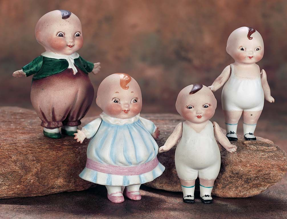 Lot: 101. Pair,German All-Bisque Mr and Mrs Happifats 1915 Theriault's Antique Doll Auctions