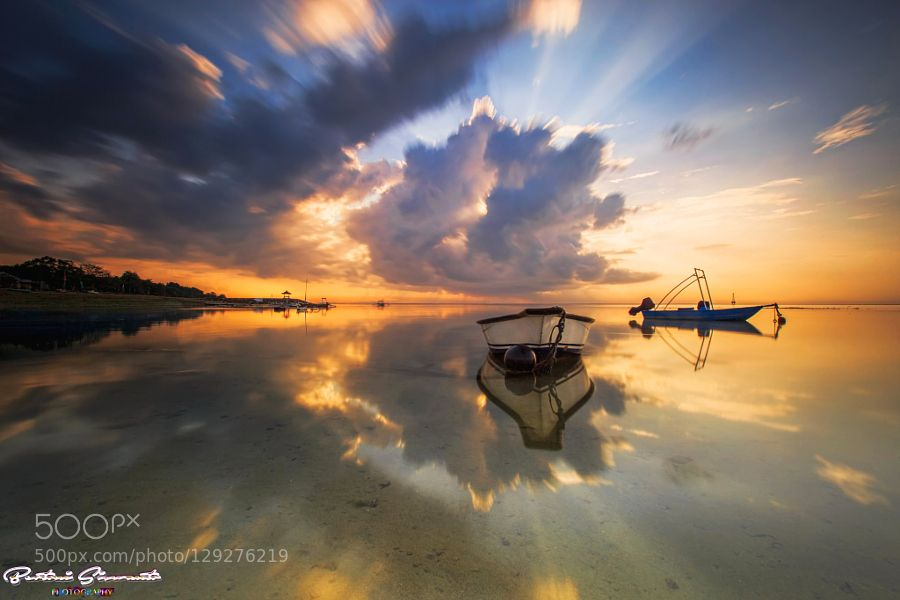 How lovely morning can see clouds suddenly from small then a bigger and bigger  also the sun hiding behind the clouds . I love take landscape with boat in my composition  hard to get angle straight with clouds so can get great composition . Just lucky of me can get this shot  thats why i called name is  Shocking Sunrise   enjoyed my photography and God Bless You all ...