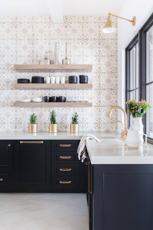 patterned backsplash, natural wood open shelves, black