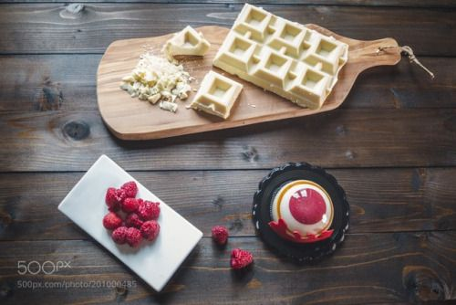Raspberry cake and white chocolate on wooden table by SilviaAmici  IFTTT 500px
