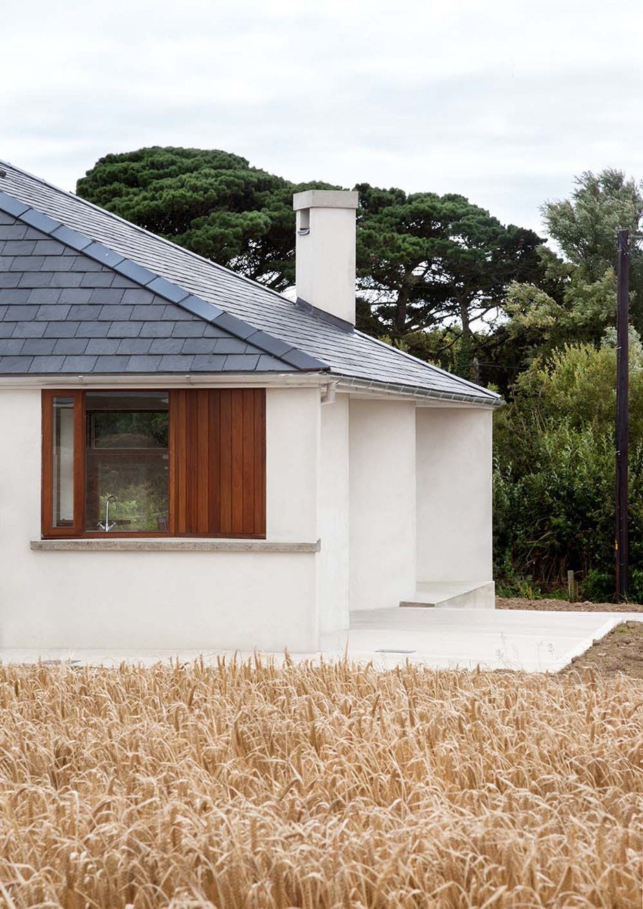Occupying A Large Site That Was Previously Farmland This House Features Lime Rendered Walls And A Pitched Roof House Roof Pyramid Roof Roof Design