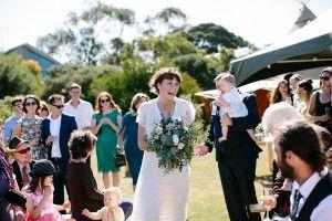 ceremony processional - photo by Love Katie and Sarah http://ruffledblog.com/relaxed-backyard-australian-wedding