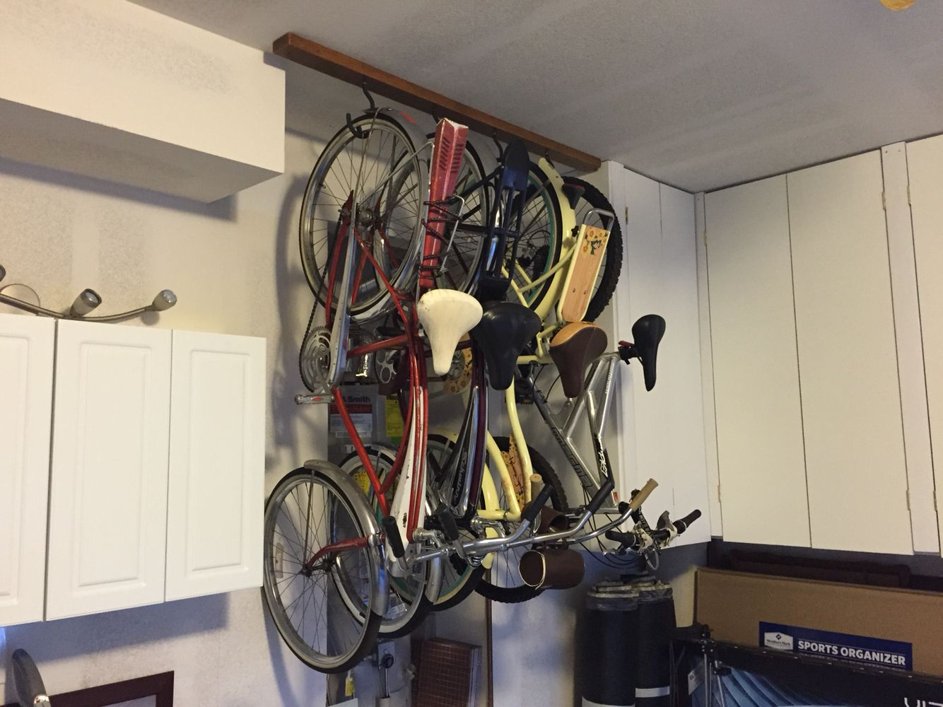 Diy Vintage Beach Cruiser Bike Rack 5ft 2x4 Stain 4 Bike Hooks And Screwed On To The 2x4 In The Ceiling Bike Storage Diy Vintage Bike Hooks