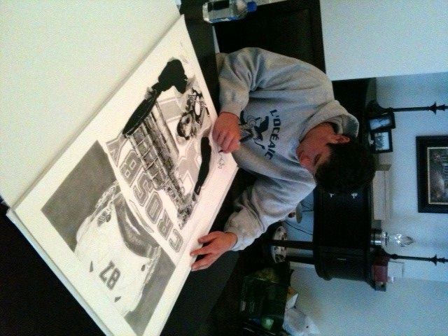 Pittsburgh Penguins star Sidney Crosby signing Robb Scott's art prints.