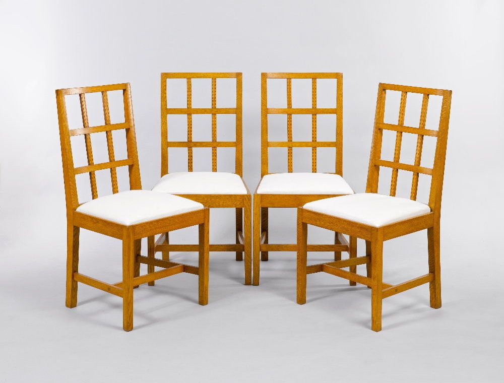 A set of four oak lattice back dining chairs with drop-in seats, the ...