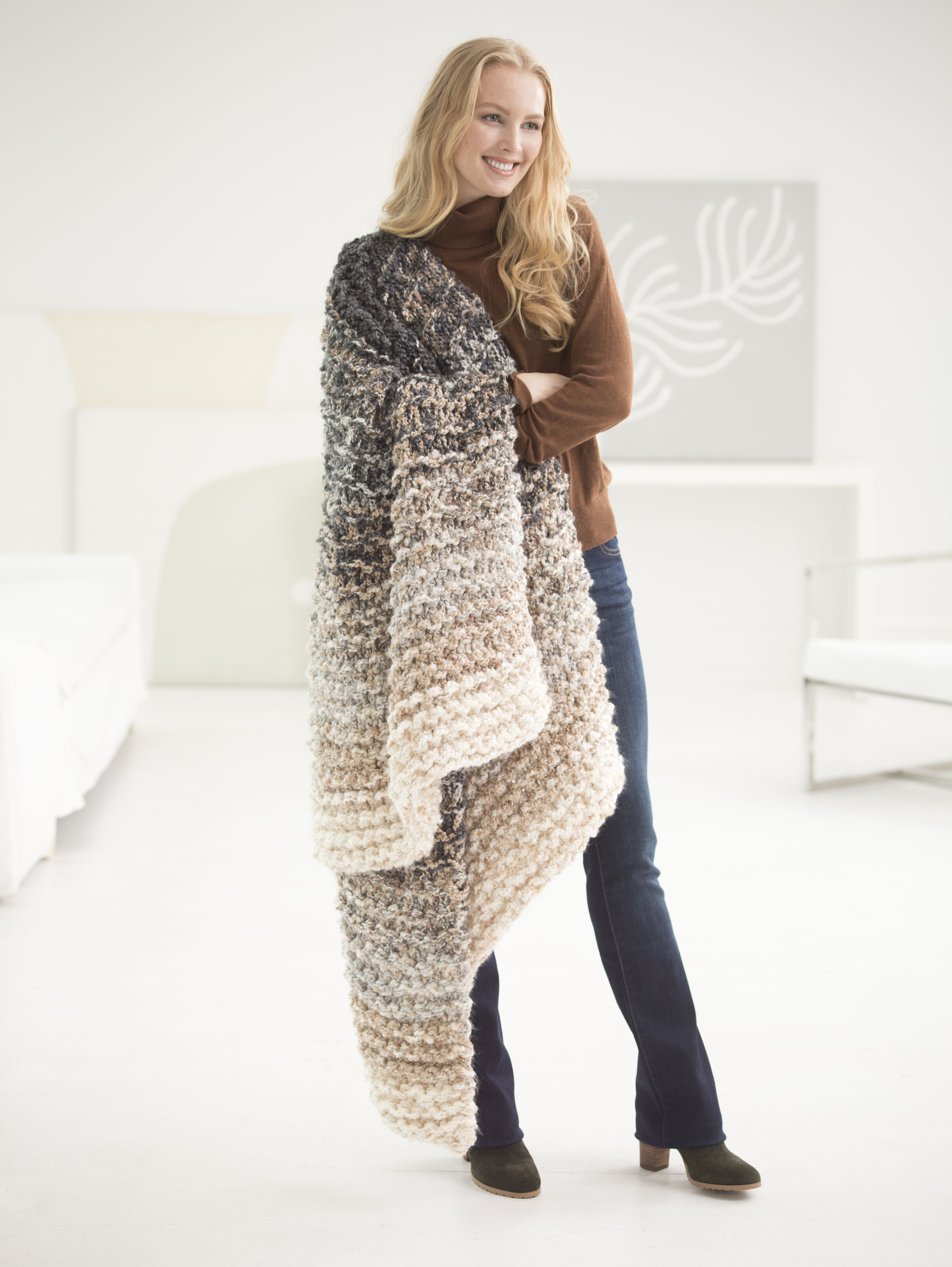 Make this trendy throw in just 8 hours with new lion brand super uses 4 strands of yarn together simple knit stitch across uses lion brand super circs circular knitting needles size 50 mm bankloansurffo Gallery