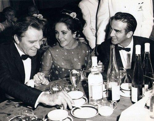 Richard Burton,Liz Taylor & Monty Clift at the premiere for The Night of the Iguana.  Liz &  Monty were good friends.