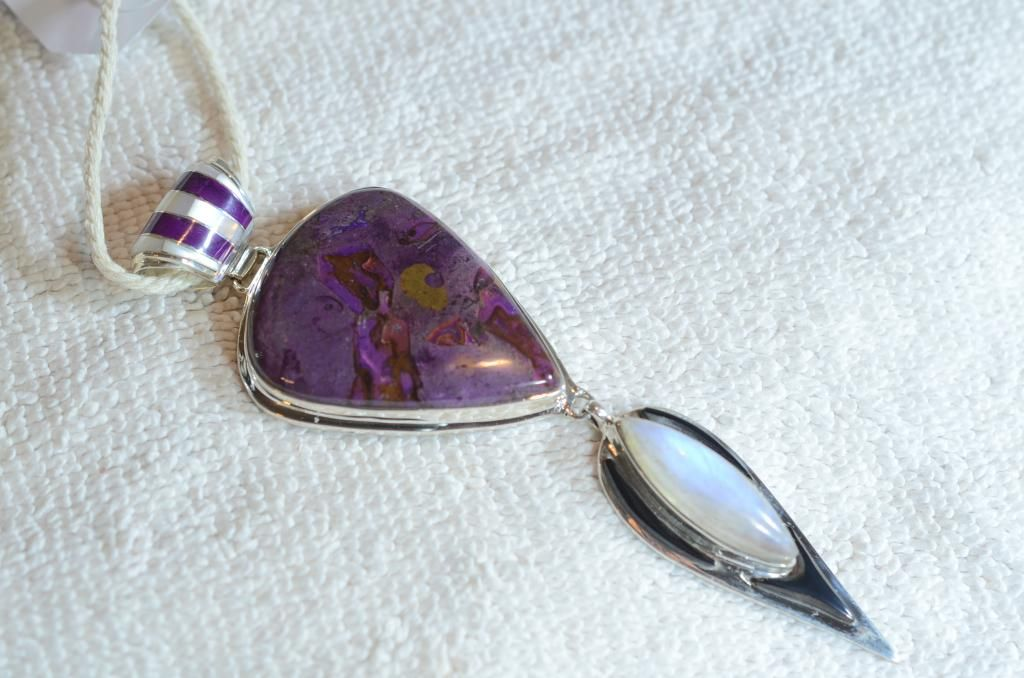 Sugilite and Rainbow Moonstone, in Sterling Silver. With an inlayed bale and…