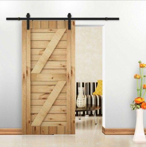 puerta corredera doble z en madera de pino maciza con barniz natural y herrajes vistos