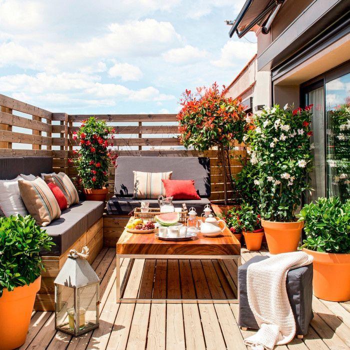 Decoracion de terrazas con deck y muebles de madera y plantas - decoracion de terrazas con plantas