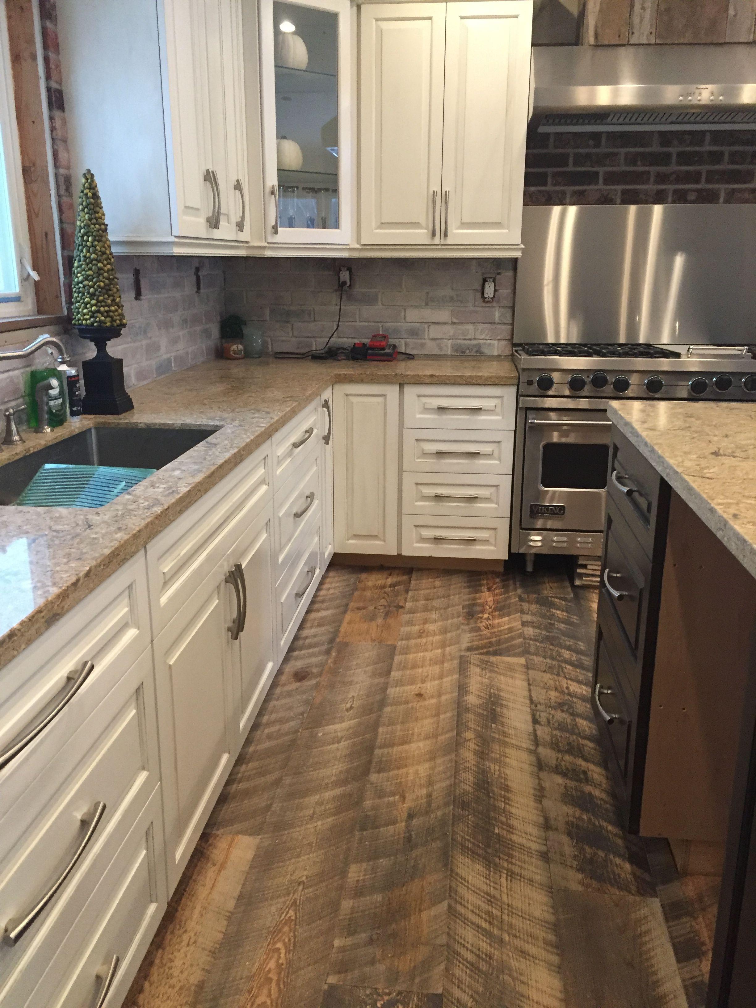 Distressed reengineered barnboard flooring. So cool! in
