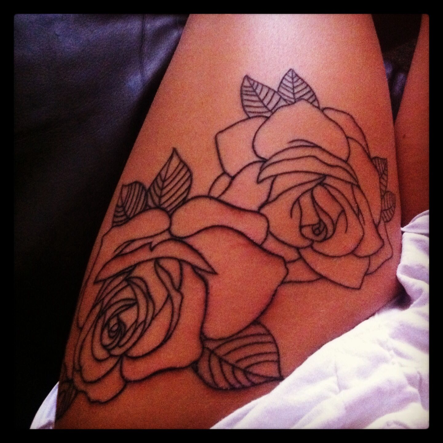 I really like the idea of not shading the roses getting for Getting thigh tattoo