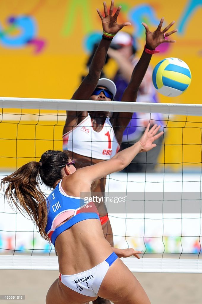 Costa Rican Player Karen Cope Tries To Block A Shot By Pilar Mardones Beach Volleyball Female Volleyball Players Volleyball