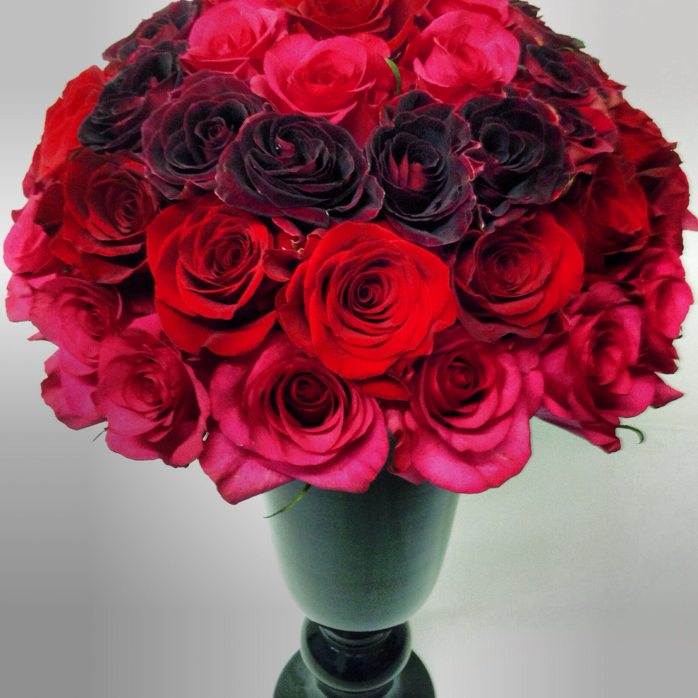 Multi shade red roses hand tied spiral bouquet price