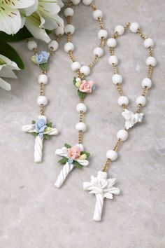 A beautiful keepsake for the precious new baby! - Mini Rosary with White Beads - Select From Blue, Pink or White Flowers - Made in the U.S.A. - Comes with Gift Box
