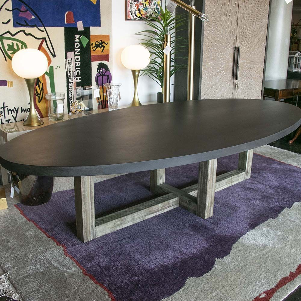 The Constantine Eli Table Has An Oval Concrete Top With A Black