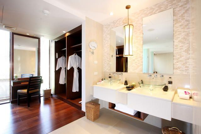 Modern bathroom with wardrobe and dressing table Master bedroom ensuite and dressing room