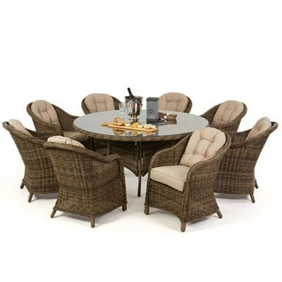 Debenhams Light brown rattan-effect \'Winchester\' round table and 8 ...