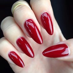 Dark red stiletto acrylics, really pretty for going on holidays or events.