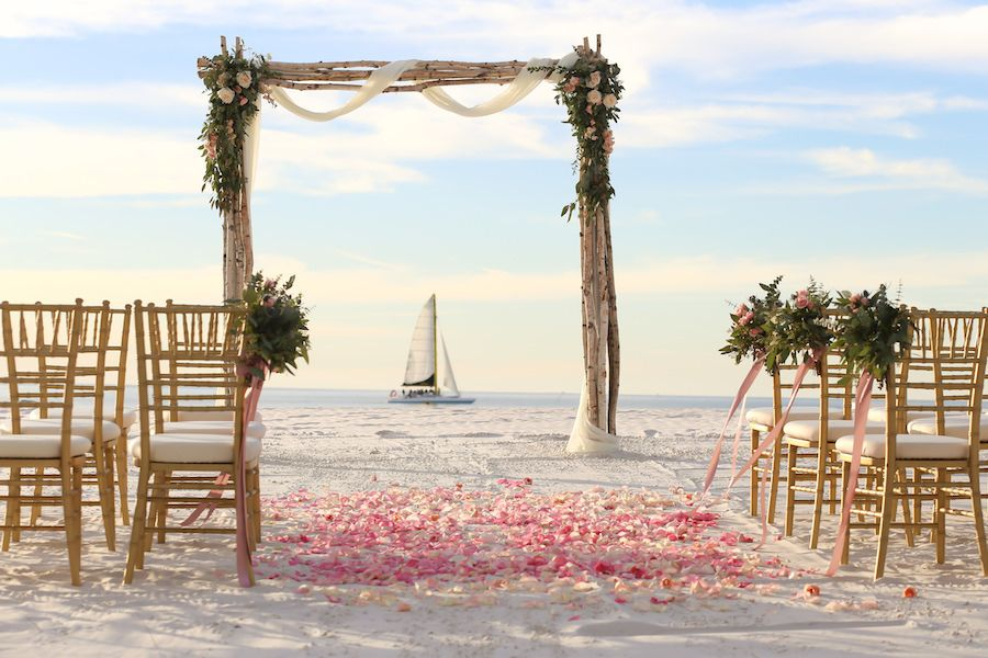 Florida Beach Oceanfront Wedding Ceremony Decor At Venue Hilton Clearwater Fl Chair Décor And Driftwood Tulle Rose Arch By