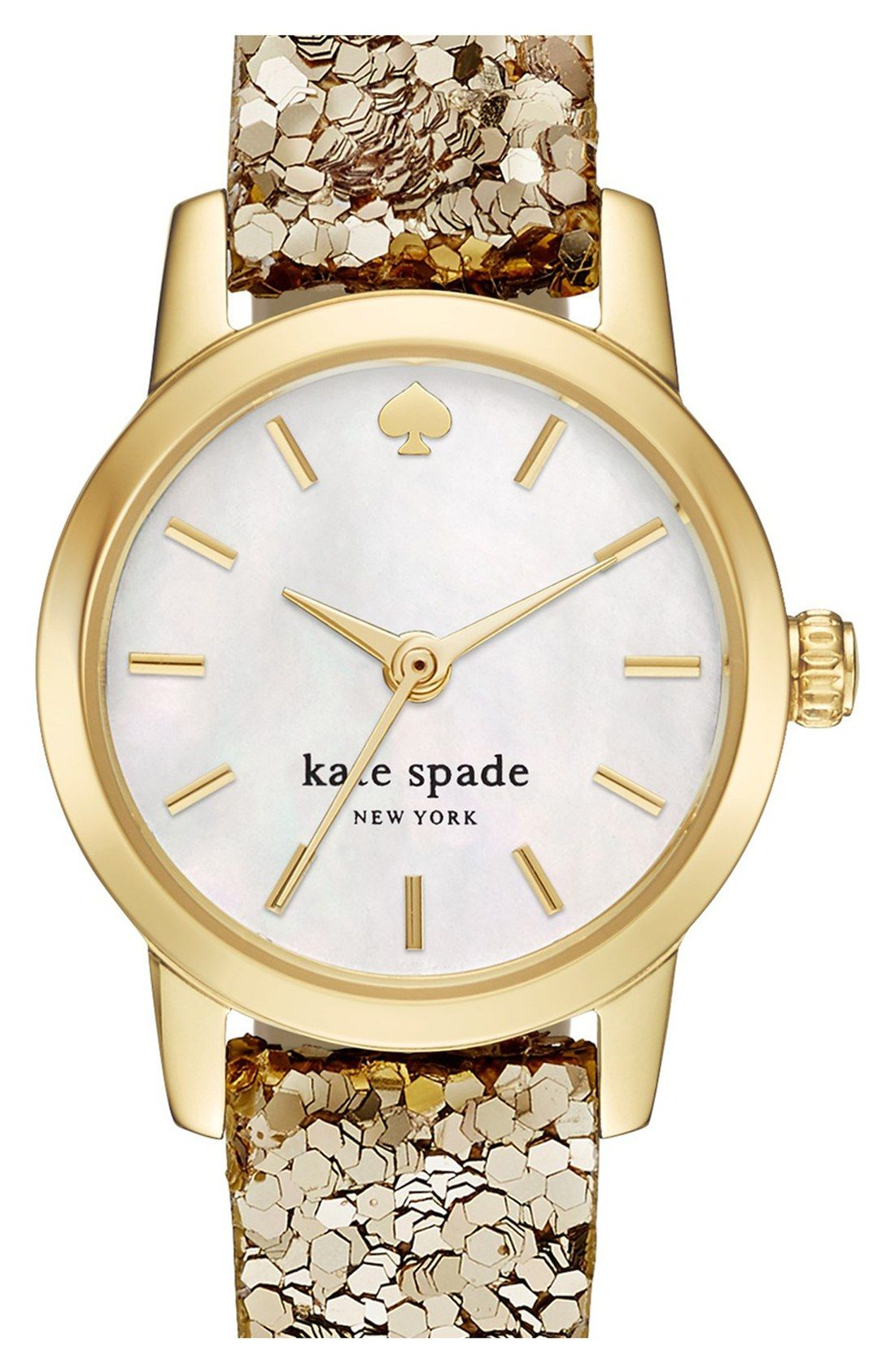 Crushing on this gold Kate Spade watch that gleams against the
