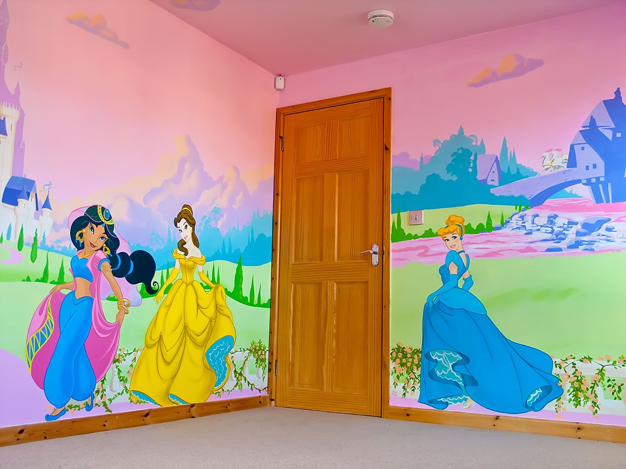 Disney mural with princesses Jasmin, Belle and Cinderella. Shows ...
