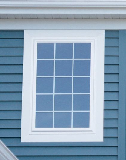 Window casing exterior picture frame with mitered joint for Vinyl window designs