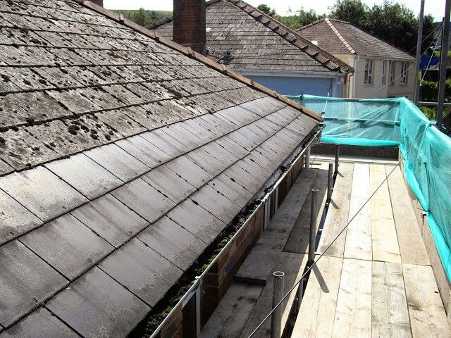 Composite Asbestos Cement Roof Tiles.The Weathered Tiles On The Top Are  Asbestos. The
