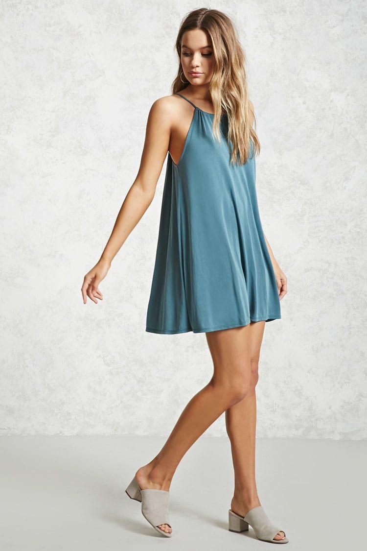 A knit trapeze dress featuring an elasticized high neck, a ...
