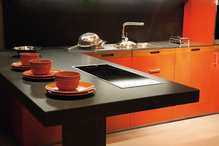 Honed Finish Black Silestone With Orange Thermophil Cabinets.