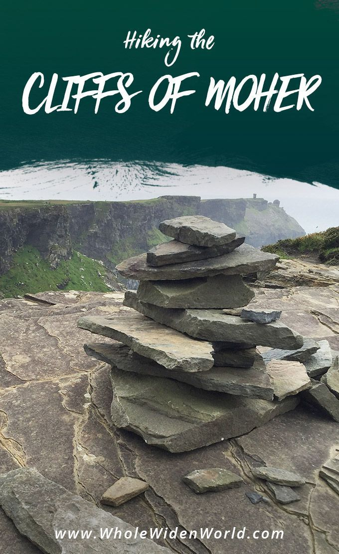 Hiking the Cliffs of Moher: Read what it's like to visit and hike the Cliffs of Moher in Ireland. See picturesque photos of the emerald wind-swept cliffs. We hiked from the Visitor's center all the way to hags head and back, winding our way along the crooked path. #ireland #cliffsofmoher #travel #traveltips #travelguide #travelstories #hiking #wholewidenworld